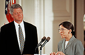 Associate Justice of the Supreme Court Ruth Bader Ginsburg, right, makes remarks prior to taking the oath of office during a swearing-in ceremony in the East Room of the White House in Washington, DC on August 10, 1993. Looking on is United States President Bill Clinton, left. Justice Ginsburg replaces Associate Justice Byron R. White.<br /> Credit: Arnie Sachs / CNP