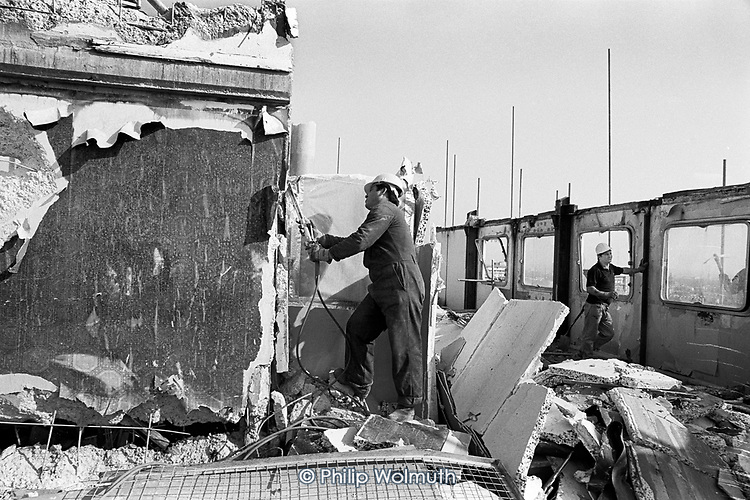 Demolition of Hermes Point, one of two asbestos-ridden towers on Elgin Estate, North Paddington,  following takeover of the estate by resident-controlled Walterton and Elgin Community Homes. London 1994.