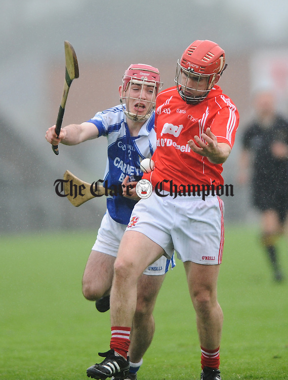 Martin O Connor of Kilmaley in action against Paddy Meaney of Crusheen during their senior championship semi-final at Cusack park. Photograph by John Kelly.