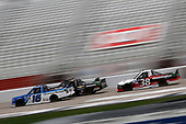 HAMPTON, GEORGIA - JUNE 06: Austin Hill, driver of the #16 United Rentals Toyota, leads Todd Gilliland, driver of the #38 Mannington Commercial Ford, during the NASCAR Gander Outdoors Truck Series Vet Tix Camping World 200 at Atlanta Motor Speedway on June 06, 2020 in Hampton, Georgia. (Photo by Chris Graythen/Getty Images)