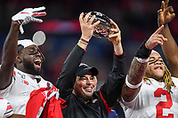 Indianapolis, IN - DEC 7, 2019: Ohio State Buckeyes head coach Ryan Day celebrates on the podium after winning the Big Ten Championship game between Wisconsin and Ohio State at Lucas Oil Stadium in Indianapolis, IN. Ohio State came back from a 21-7 deficit at halftime to beat Wisconsin 34-21 to win its third straight Big Ten Championship. (Photo by Phillip Peters/Media Images International)