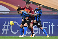 Lautaro Martinez of FC Internazionale , Gianluca Mancini of AS Roma and Arturo Vidal of FC Internazionale compete for the ball during the Serie A football match between AS Roma and FC Internazionale at Olimpico stadium in Roma (Italy), January 10th, 2021. Photo Andrea Staccioli / Insidefoto