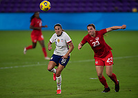 ORLANDO CITY, FL - FEBRUARY 18: Carli Lloyd #10 and Vanessa Gilles #23 follow the ball during a game between Canada and USWNT at Exploria stadium on February 18, 2021 in Orlando City, Florida.