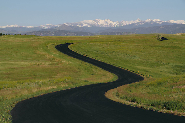 Winding paved road in the foothills with the Indian Peaks Wilderness Area behind, Boulder, Colorado. .  John leads private photo tours in Boulder and throughout Colorado. Year-round Colorado photo tours.