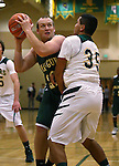Alumni Dominic Anxo, left, and Miners' Jack Mayer compete in the alumni game at the Wild West Shootout at Bishop Manogue High School in Reno, Nev., on Wednesday, Dec. 4, 2013. The Miners defeated the alumni 79-62. <br /> Photo by Cathleen Allison