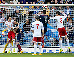 Steven Fletcher held back by defender Akaki Khubutia at a corner kick