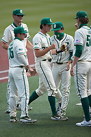 Charlotte 49ers starting pitcher Andrew Lindsey (32) is greeted by his teammates as he leaves the field during the game against the Old Dominion Monarchs at Hayes Stadium on April 25, 2021 in Charlotte, North Carolina. (Brian Westerholt/Four Seam Images)