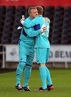 (L-R) Roger Freestone hugs Gerhard Tremmel during the Alan Tate Testimonial Match, Swansea City Legends v Manchester United Legends at the Liberty Stadium, Swansea, Wales, UK
