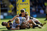 Jackson Wray of Saracens charges over to score a try despite the attentions of Jake Cooper-Woolley and Jonah Holmes of London Wasps during the Aviva Premiership match between London Wasps and Saracens at Adams Park on Saturday 29th March 2014 (Photo by Rob Munro)