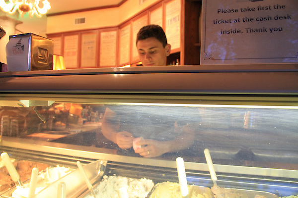 Man selling gelato in downtown Milan, Italy.