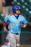 Tennessee Smokies catcher Kyle Schwarber (12) runs to first during a game against the Montgomery Biscuits on May 25, 2015 at Riverwalk Stadium in Montgomery, Alabama.  Tennessee defeated Montgomery 6-3 as the game was called after eight innings due to rain.  (Mike Janes/Four Seam Images)