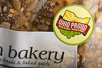 """Sticker on a package of commercial bread from a natural foods grocery store promoting buying local --""""Ohio Proud, Made in Ohio, Grown in Ohio"""", USA"""