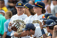 Michigan Wolverines first baseman Jimmy Kerr (15) before Game 2 of the NCAA College World Series Finals on June 25, 2019 at TD Ameritrade Park in Omaha, Nebraska. Vanderbilt defeated Michigan 4-1. (Andrew Woolley/Four Seam Images)