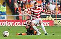 Dundee Utd's John Rankin challenges Hamilton's Grant Gillespie.