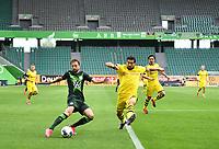 23rd May 2020, Volkswagen Arena, Wolfsburg, Lower Saxony, Germany; Bundesliga football,VfL Wolfsburg versus Borussia Dortmund;  Admir Mehmedi sees  Emre Can (Dortmund) attempt to block the cross