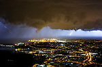 Photos show a tornado forming above the lights of a city, as lightning also strikes in a supercell storm.  The dramatic scenes took place above the Italian port city of Trieste last night (Monday), where three centimetre hail was also reported to have fallen.<br /> <br /> The photos were taken by weather photographer Marko Korošec, who also works as a forecaster for extreme European weather page Severe Weather Europe.  SEE OUR COPY FOR DETAILS.<br /> <br /> Please byline: Marko Korosec/Solent News<br /> <br /> © Marko Korosec/Solent News & Photo Agency<br /> UK +44 (0) 2380 458800