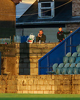 Cobh Ramblers supporters watch the game from the wall.<br /> <br /> Cobh Ramblers v Cork City, SSE Airtricity League Division 1, 28/5/21, St. Colman's Park, Cobh.<br /> <br /> Copyright Steve Alfred 2021.
