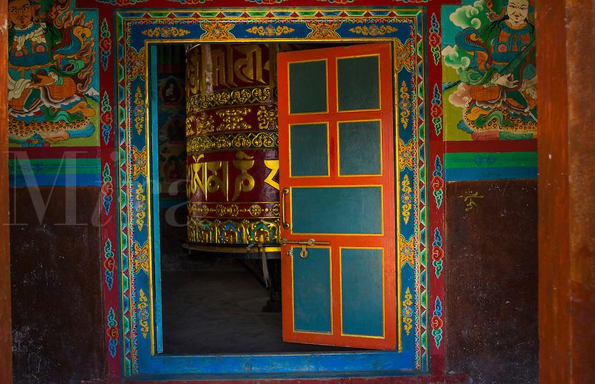 Nepal Lukla Prayer wheel in a shrine in Lukla Nepal.