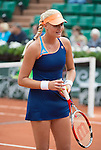Kristina Mladenovic (FRA) defeats Na Li (CHN) at  Roland Garros being played at Stade Roland Garros in Paris, France on May 27, 2014