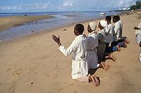 "- religious ceremony of the neo  evangelical sect of ""Maziones"" on the beach of Maputo....- cerimonia religiosa della setta neo evangelica dei ""Mazioni"" sulla spiaggia di Maputo"