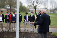 Dave Louk of Elm Springs speaks to students Wednesday April 7, 2021 at Ozark Catholic Academy in Tontitown during a dedication ceremony for a flag pole recently installed on campus. Louk and his wife Patsy donated the pole and flag. Louk, a retired Navy Commander, is chairman of the flag education program for the Northwest Arkansas chapter of the Military Officers Association of America.<br />Visit nwaonline.com/210408Daily/ and nwadg.com/photos. (NWA Democrat-Gazette/J.T. Wampler)