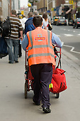 Postman on a delivery round in Paddington.