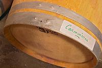 An oak barrel marked with Carmenere, an unusual grape variety in Bordeaux, almost on its way to disappear  Chateau de Pressac St Etienne de Lisse  Saint Emilion  Bordeaux Gironde Aquitaine France