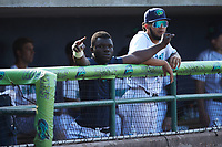 Jhonkensy Noel (left) watches from the dugout after coming out of the game after having been hit by a pitch against the Myrtle Beach Pelicans at Bank of the James Stadium on May 23, 2021 in Lynchburg, Virginia. (Brian Westerholt/Four Seam Images)