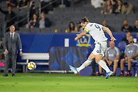 CARSON, CA - SEPTEMBER 15: Zlatan Ibrahimovic #9 of the Los Angeles Galaxy crosses a ball during a game between Sporting Kansas City and Los Angeles Galaxy at Dignity Health Sports Park on September 15, 2019 in Carson, California.