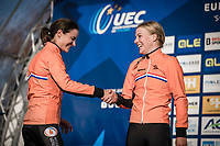 Podium women's elite:<br /> <br /> new European champion Annemarie Worst (NED) is congratulated by the former: Marianne Vos (NED)<br /> <br /> UEC CYCLO-CROSS EUROPEAN CHAMPIONSHIPS 2018<br /> 's-Hertogenbosch – The Netherlands<br /> Women's Elite Race