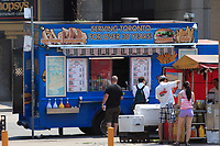 Toronto (ON) CANADA - July 2012 - Hot dog stand in front of Toronto City Hall