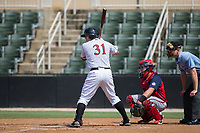 Jake Burger (31) of the Kannapolis Intimidators at bat against the Hagerstown Suns at Kannapolis Intimidators Stadium on July 9, 2017 in Kannapolis, North Carolina.  The Intimidators defeated the Suns 3-2 in game one of a double-header.  (Brian Westerholt/Four Seam Images)
