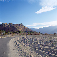 View of a rural road near Palm Springs, the desert city in Riverside County, California