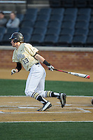 Keegan Maronpot (13) of the Wake Forest Demon Deacons follows through on his swing against the UConn Huskies at Wake Forest Baseball Park on March 17, 2015 in Winston-Salem, North Carolina.  The Demon Deacons defeated the Huskies 6-2.  (Brian Westerholt/Four Seam Images)