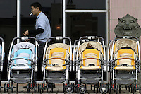 Strollers wait to be tested outside the Japanes-owned Combi Strollers factory in Tangxia, Dongguan City, Guangdong Province, China..26-MAR-04