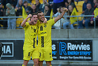 Wellington's Cameron Devlin (left) congratulates Clayton Lewis on his goal during the A-League football match between Wellington Phoenix and Western United FC at Sky Stadium in Wellington, New Zealand on Saturday, 22 May 2021. Photo: Dave Lintott / lintottphoto.co.nz