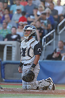 Fernando Pujadas (22) of the Salem-Keizer Volcanoes in the field at catcher during a game against the Hillsboro Hops at Ron Tonkin Field on July 27, 2015 in Hillsboro, Oregon. Hillsboro defeated Salem-Keizer, 9-2. (Larry Goren/Four Seam Images)
