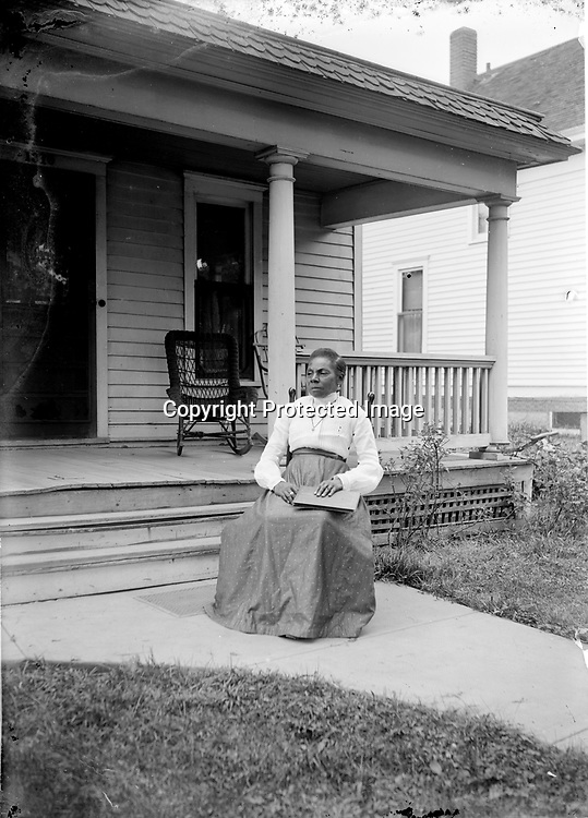 MOTHER MARGARET JOHNSON. Margaret Johnson was born in Mississippi in 1854, probably in slavery, and died in Lincoln in 1926. After her husband, Harrison, died in 1900, she lived with her son, John (1879-1953). His wife, Odessa, joined the household upon their marriage in 1918. Ruth Folley remembered Margaret as a small, prim woman who rode to church ramrod-straight in John's horse-drawn wagon.<br /> <br /> Photographs taken on black and white glass negatives by African American photographer(s) John Johnson and Earl McWilliams from 1910 to 1925 in Lincoln, Nebraska. Douglas Keister has 280 5x7 glass negatives taken by these photographers. Larger scans available on request.