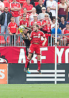 29 June 2013: Real Salt Lake goalkeeper Nick Rimando #18 and Toronto FC forward Jeremy Brockie #22 in action during an MLS game between Real Salt Lake and Toronto FC at BMO Field in Toronto, Ontario Canada.<br /> Real Salt Lake won 1-0.