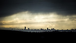 © Joel Goodman - 07973 332324 . 20/02/2014 . Manchester , UK . Landscape view across Manchester taken from Saddleworth near Oldham , featuring the city's iconic Beetham Tower on the left and the Piccadilly Tower Town Hall and Arndale Centre to its right with the cooling towers of Fiddlers Ferry power station , in Cheshire , in the distance . Photo credit : Joel Goodman