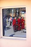 Buddhist monks reflected in window, Gandantegchinlen Monastery, Ulaanbaatar, Mongolia