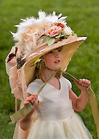 A young girl shows off her themed hat during the Queen's Cup Steeplechase in Mineral Springs, NC.