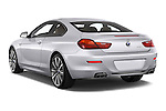 Car pictures of rear three quarter view of a 2015 BMW 6 Series Experience 2 Door Coupe Angular Rear