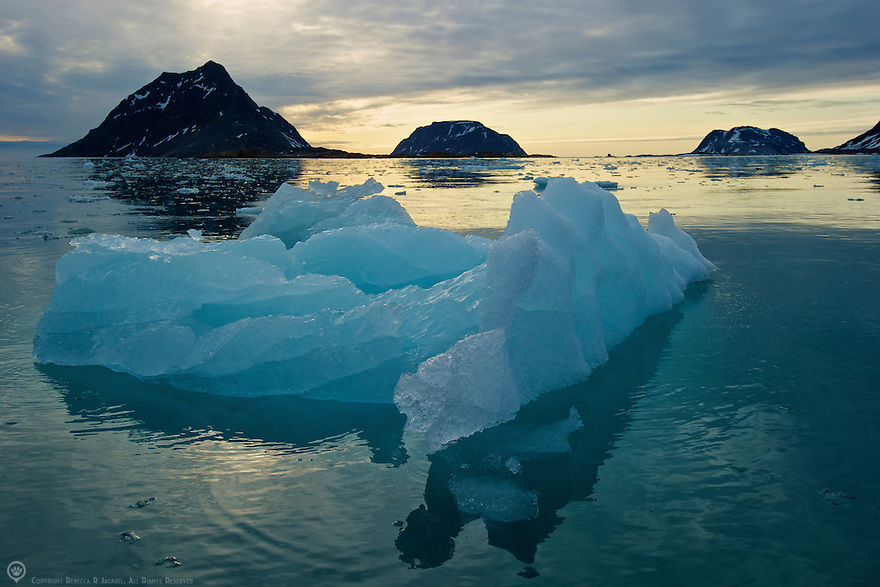 A chunk of glacial ice floating in Smeerenburgfjorden, Spitsbergen, Svalbard around midnight.