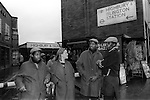 Chuka and Dubem Okonkwo who became known as Chet and Joe Okonkwo with older brother Francis (right). Thy had a following of local teenagers, local girl hanging out with them.  They are the so called Islington Twins who hung out at 'The Bar' outside Highbury and Islington tube station. London Uk 1984.