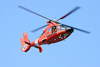 United States Coast Guard HH-65C Dolphin helicopter in flight over San Francisco Bay during the 2009 San Francisco Fleet Week Airshow.