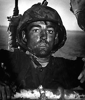 Back to a Coast Guard assault transport comes this Marine after two days and nights of Hell on the beach of Eniwetok in the Marshall Islands.  His face is grimey with coral dust but the light of battle stays in his eyes.  February 1944. (Coast Guard)<br /> Exact Date Shot Unknown<br /> NARA FILE #:  026-G-3394<br /> WAR & CONFLICT BOOK #:  1198