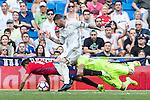 Real Madrid's Sergio Ramos Kiko Casilla and Club Atletico Osasuna's Jaime Romero during the match of La Liga between Real Madrid and Club Atletico Osasuna at Santiago Bernabeu Estadium in Madrid. September 10, 2016. (ALTERPHOTOS/Rodrigo Jimenez)