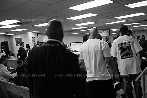 Chicago, Illinois USA<br /> July  2011<br /> <br /> Friends and family members of Deandre Douglas prepare to view him for the last time. The service took place at Greater True Light M.B. Church. Deandre 19,  was murdered on Saturday, July 10, 2011 on the 1400 block of South Millard Ave. No arrested have been made. Deandre was a member of the CYBC  boxing team on the city's West side.