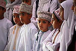 A group school children in traditional dress. Muscat. Oman